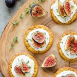 Whipped goat cheese fig bites on wooden server