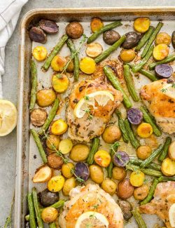 overhead shot of sheet pan chicken thighs and potatoes