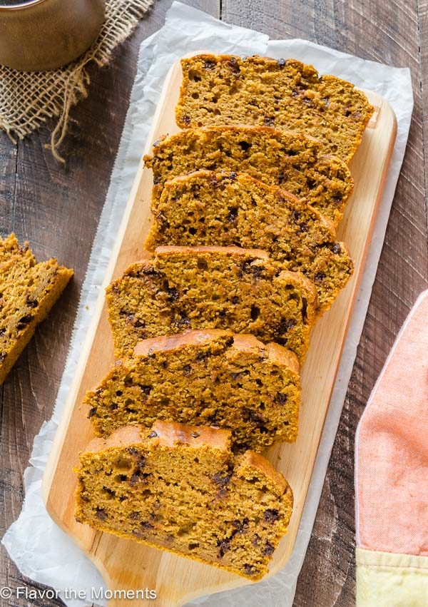 overhead shot of healthy pumpkin bread sliced on a cutting board