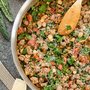 Lentil casserole in skillet with wooden spoon