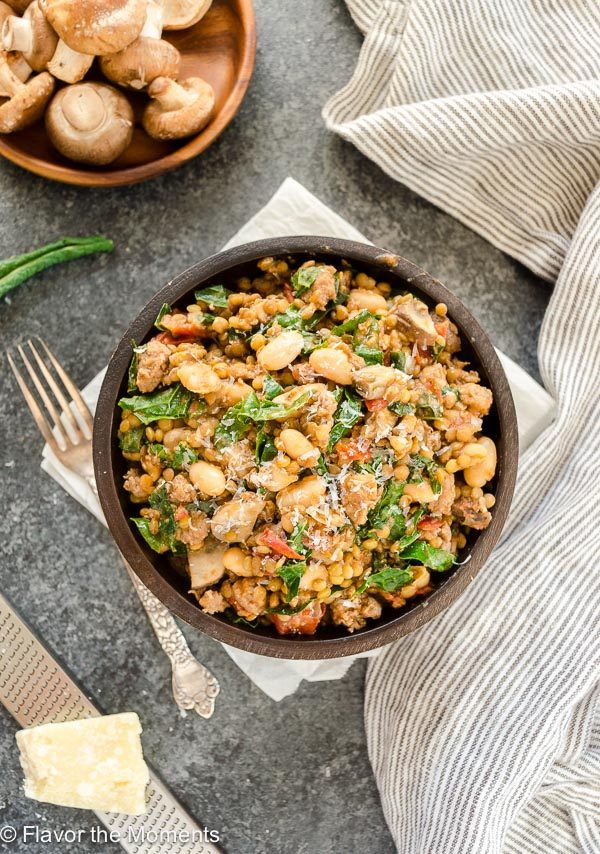 Serving of sausage kale skillet with wooden spoon