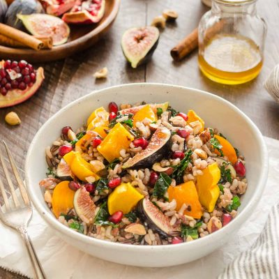 Roasted Delicata Squash, Fig and Persimmon Wild Rice Salad is packed with kale, pomegranate, and tossed in a spiced maple vinaigrette! {V, GF}