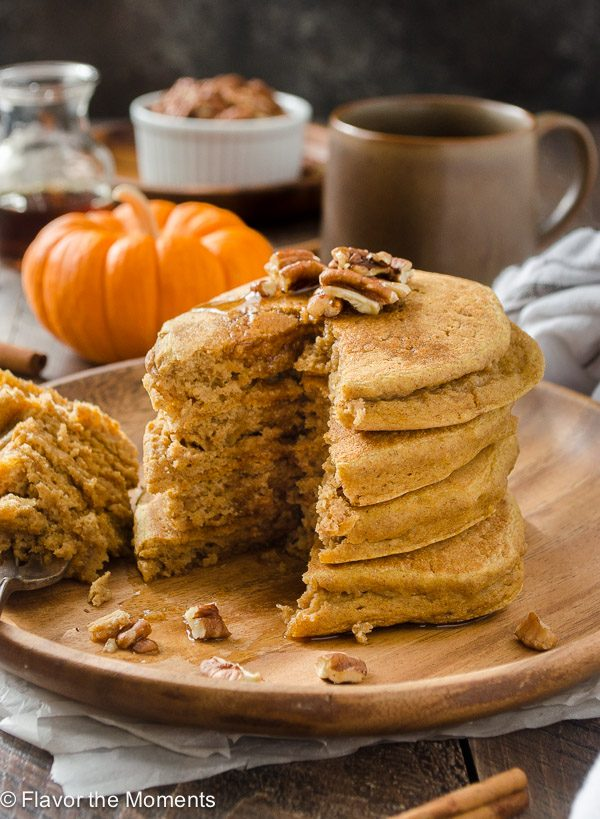 Fluffy Whole Wheat Pumpkin Pancakes are hearty, whole wheat pancakes packed with pumpkin and warm spices.  You won't believe how fluffy they are!