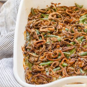 Homemade green bean casserole in baking dish with crispy shallots on top