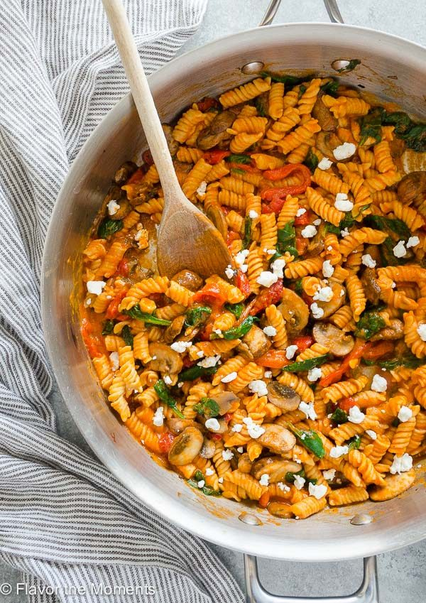 Roasted Red Pepper Pasta in a skillet with wooden spoon
