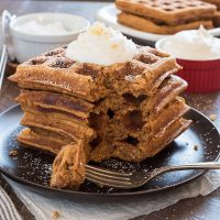 Stack of gingerbread waffles with a bite out
