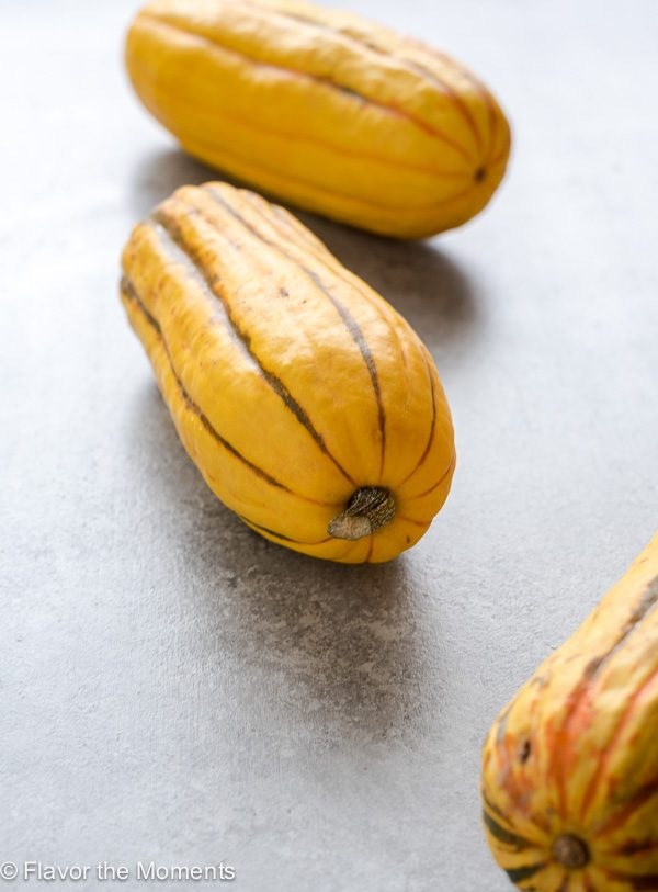 Produce of the Month Guide: Delicata Squash includes everything you want to know about delicata squash with a video tutorial on how to prep it and a recipe round up!