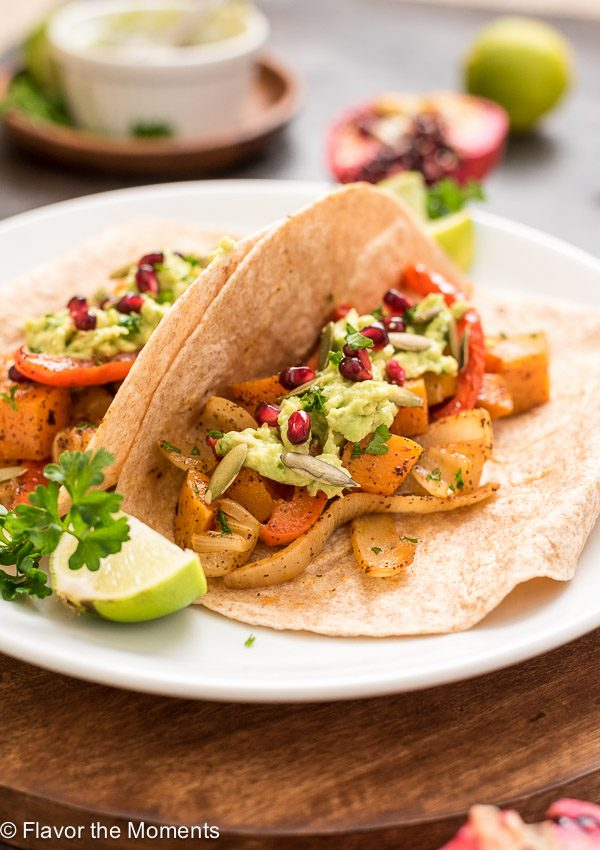 Two butternut squash fajitas on a plate