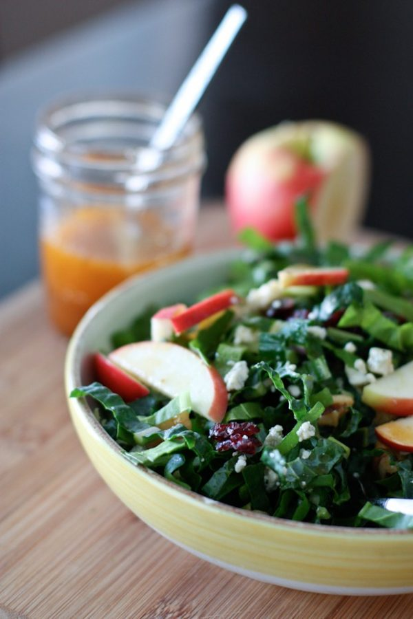 Kale and chard power salad in white bowl