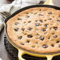 Chocolate chip skillet cookie on wire rack