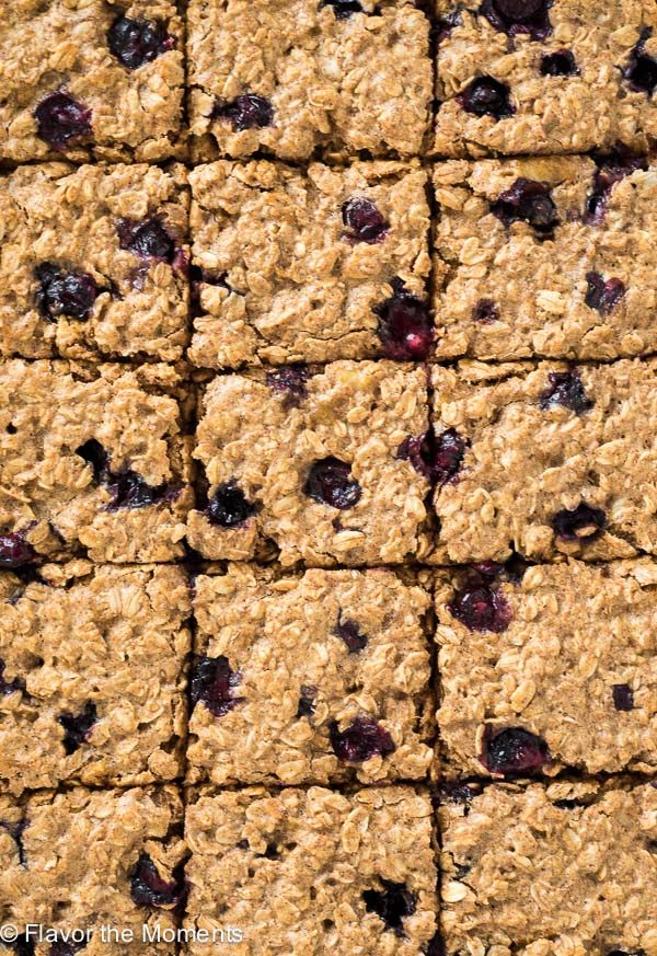 Blueberry Banana Almond Butter Oat Bars on a wire rack
