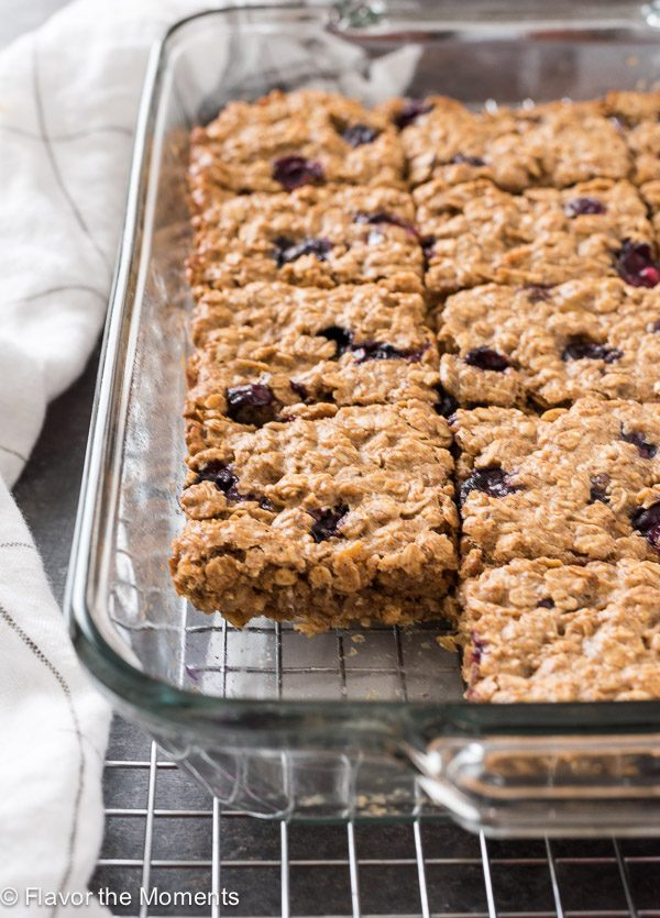Blueberry Banana Almond Butter Oat Bars cut into squares in baking dish