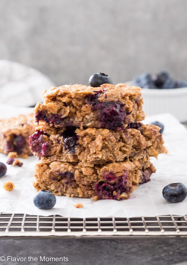 Blueberry Banana Almond Butter Oat Bars stacked on parchment