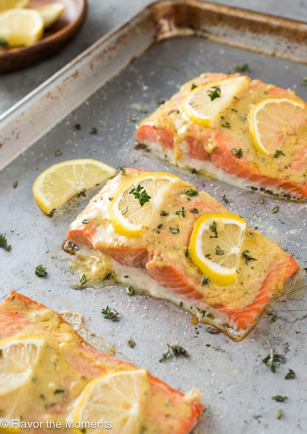 baked lemon dijon salmon on baking sheet