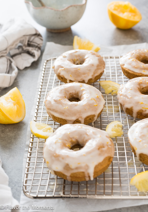 front shot of lemon donuts on wire rack