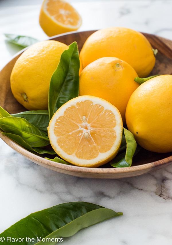 Bowl of lemons with front lemon cut in half