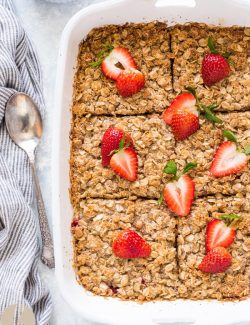Strawberry rhubarb crisp baked oatmeal cut into squares in baking dish