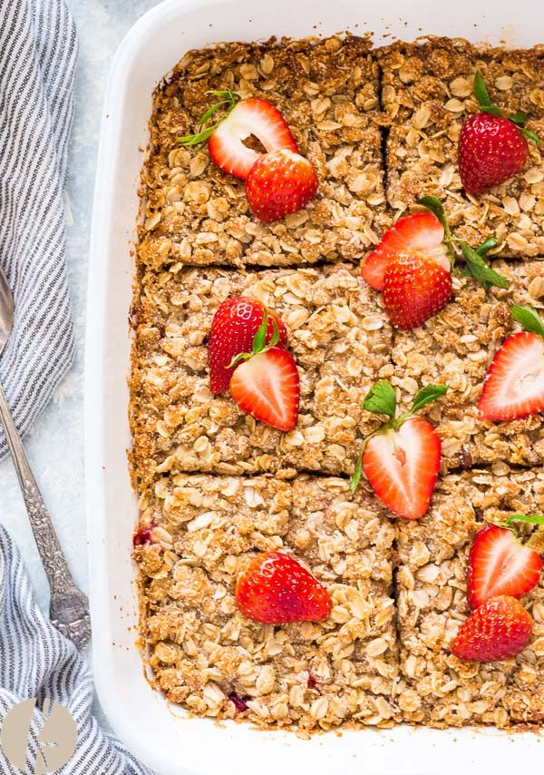 Close up of strawberry rhubarb crisp baked oatmeal cut into squares