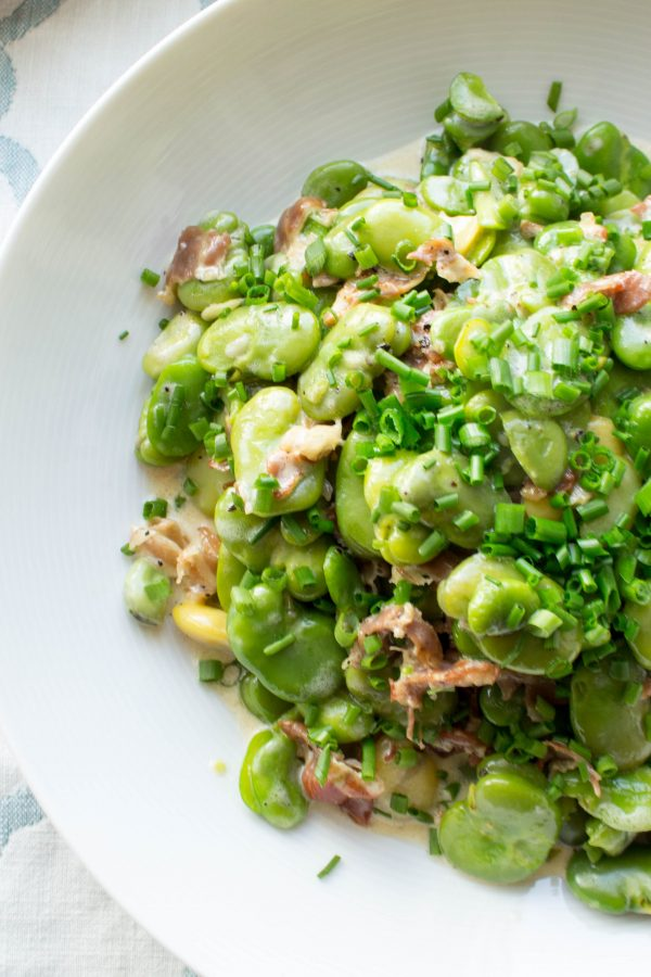 Fava bean salad on white plate
