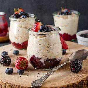 Chia jam overnight oats in jars on serving platter