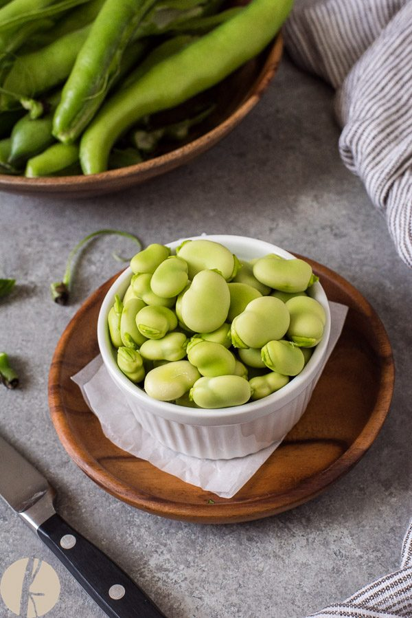 Shelled fava beans in white ramekin