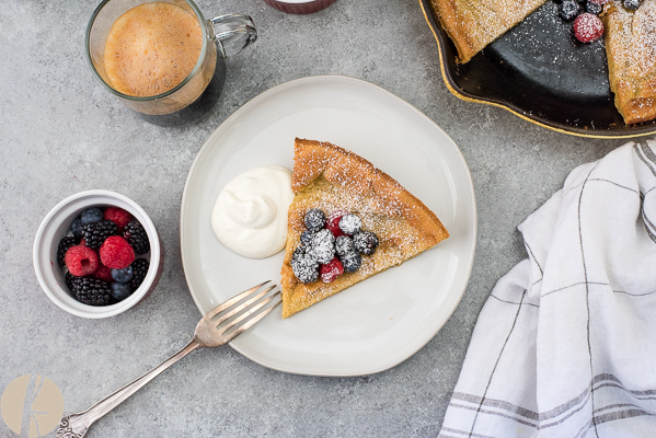 Mixed Berry Dutch Baby Pancake is an easy light, puffy skillet pancake topped with mixed berries, whipped cream and powdered sugar!