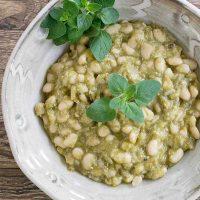 Tomatillo white beans in a white bowl