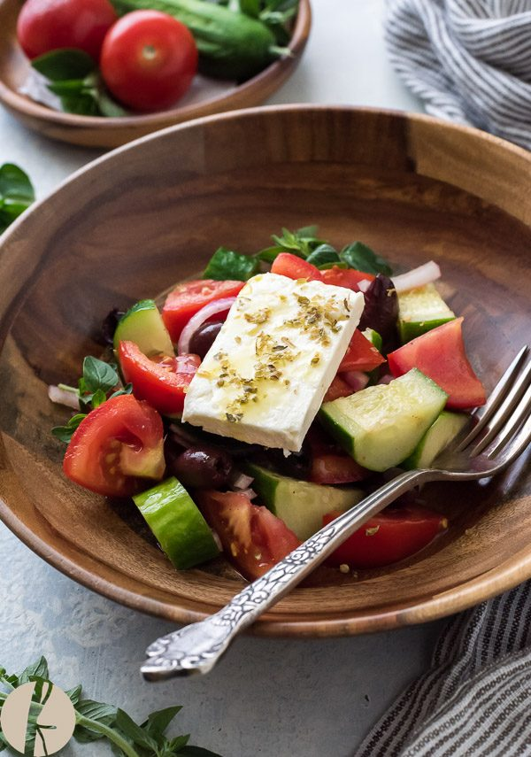Greek Village Salad {Horiatiki} is a classic Greek salad with no lettuce. It's simple, rustic and comes together in minutes!