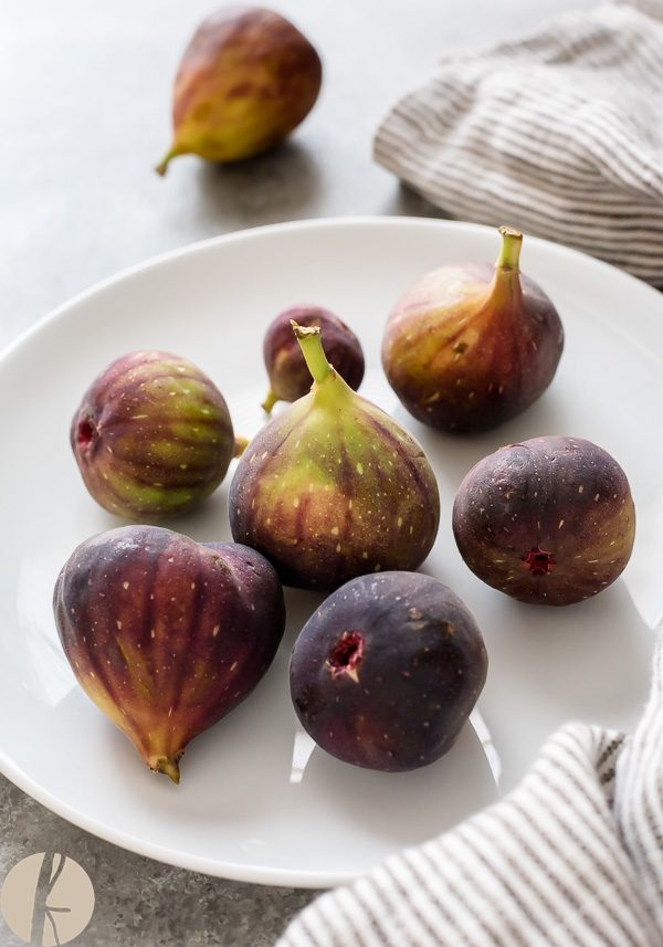 Brown figs on a white plate