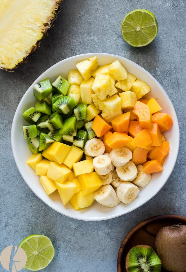 Tropical fruit salad in a bowl before mixing