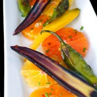 Citrus carrot salad on white plate