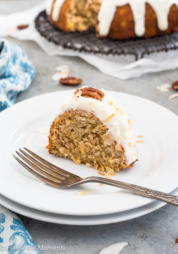 Slice of Brown Butter Hummingbird cake on a plate with fork