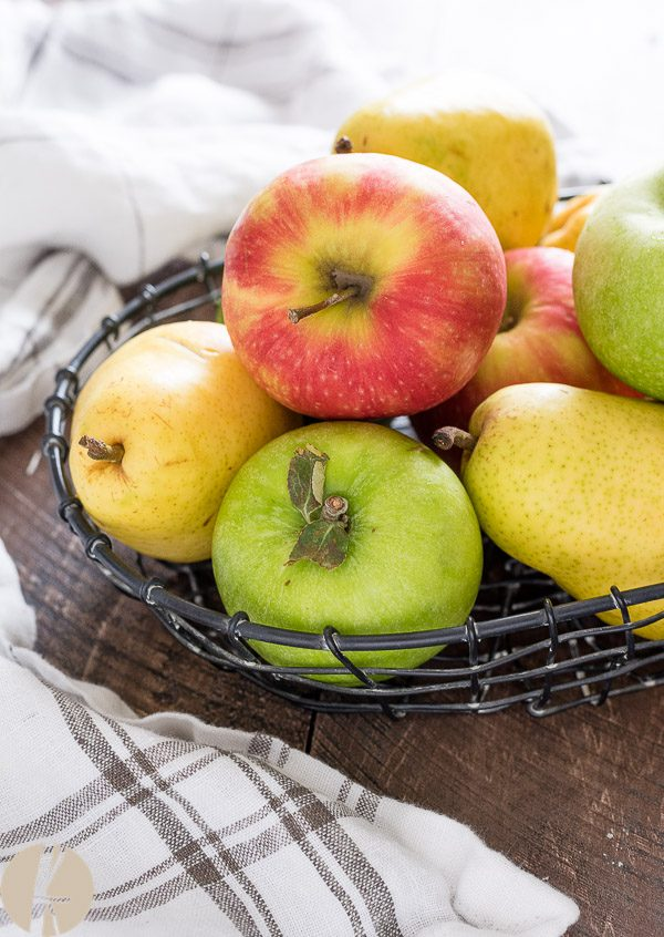 Apples and pears in a wire basket