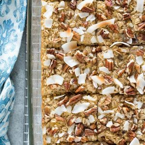 Hummingbird cake baked oatmeal cut into squares in baking dish