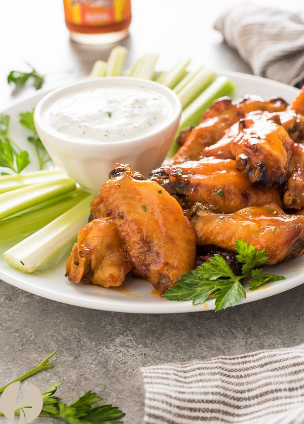 instant pot chicken wings on platter with ranch dip and celery