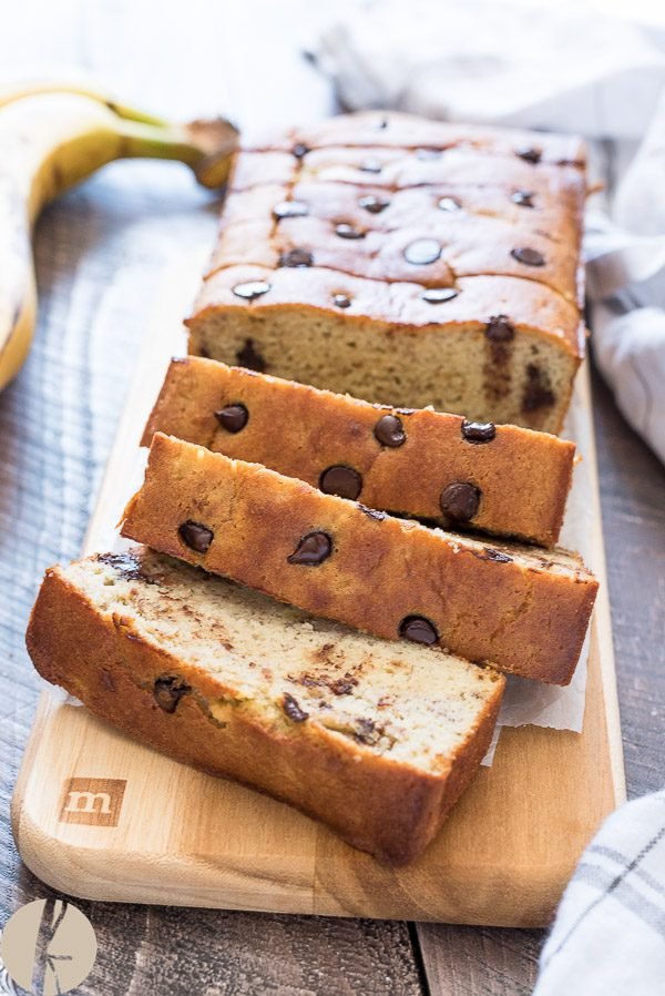 front view of gluten free banana bread sliced on a cutting board