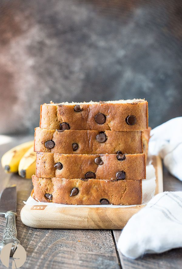 front view of stack of gluten free banana bread slices on a cutting board