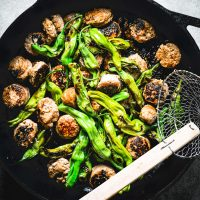 Skillet of shishito peppers and sausage