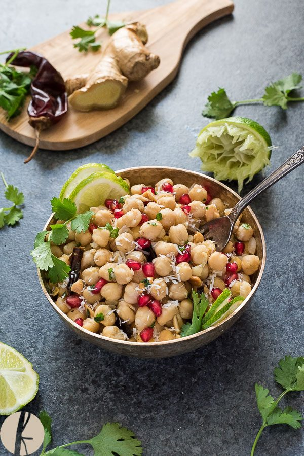 Chickpea salad in bowl with pomegranate lime and cilantro