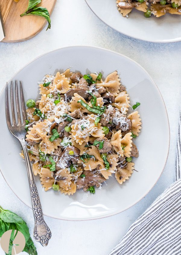 One Pot Farfalle Pasta with Sausage, Mushrooms and Peas is an easy, 30 minute one pot pasta recipe that the whole family will love!