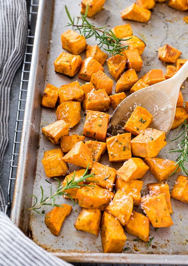 front view of roasted sweet potatoes on baking sheet