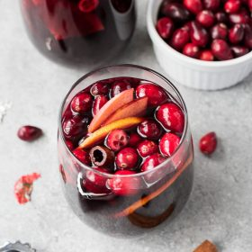 Cranberry Sangria is a refreshing holiday sangria with fruity red wine, fresh cranberries and warm cinnamon spice.  It's perfect for entertaining!
