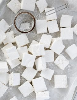 Homemade marshmallows scattered on waxed paper