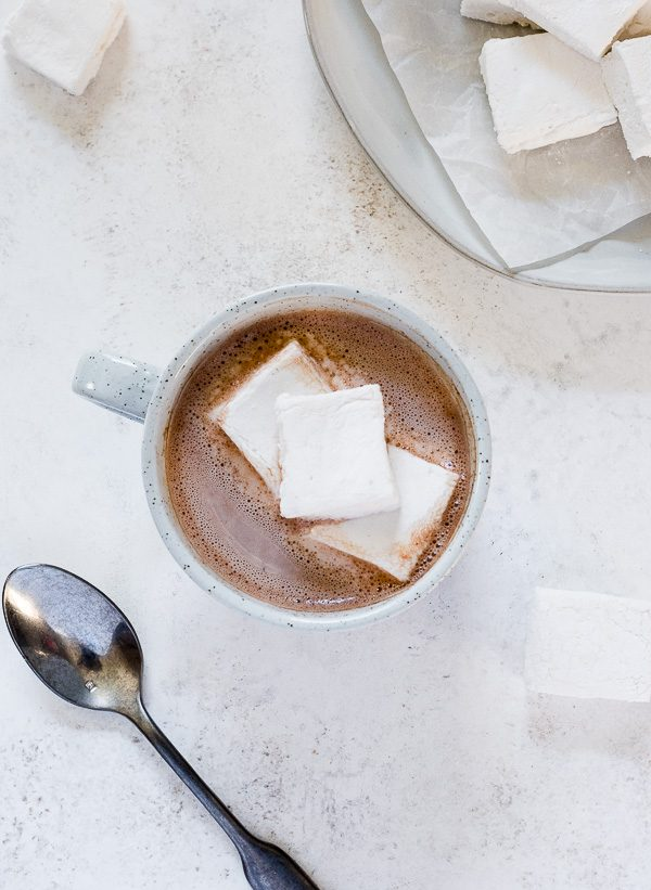 Overhead shot of dairy free hot chocolate in a mug with marshmallows on top