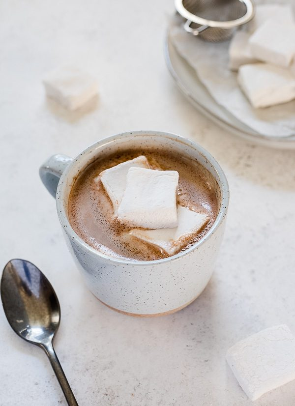 Dairy free hot chocolate in a mug with marshmallows on top