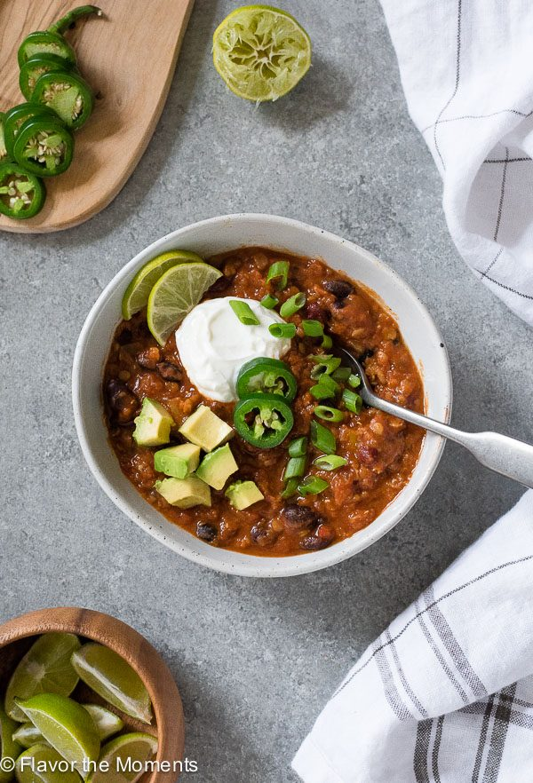 overhead shot of lentil chili with spoon dipped into bowl