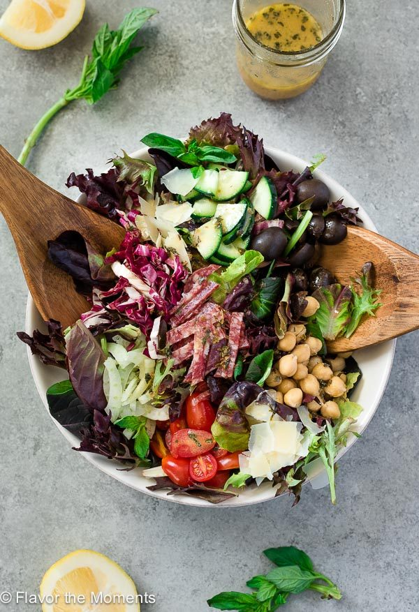 Overhead shot of Italian chopped salad with wooden servers