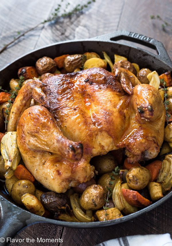 Roasted spatchcock chicken in skillet with potatoes, fennel and carrots