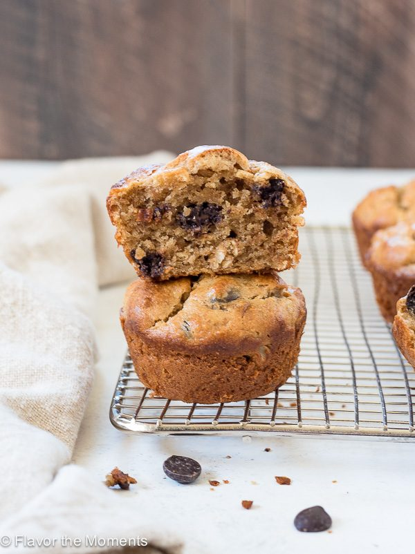 Flourless peanut butter banana muffins stacked up on a wire rack