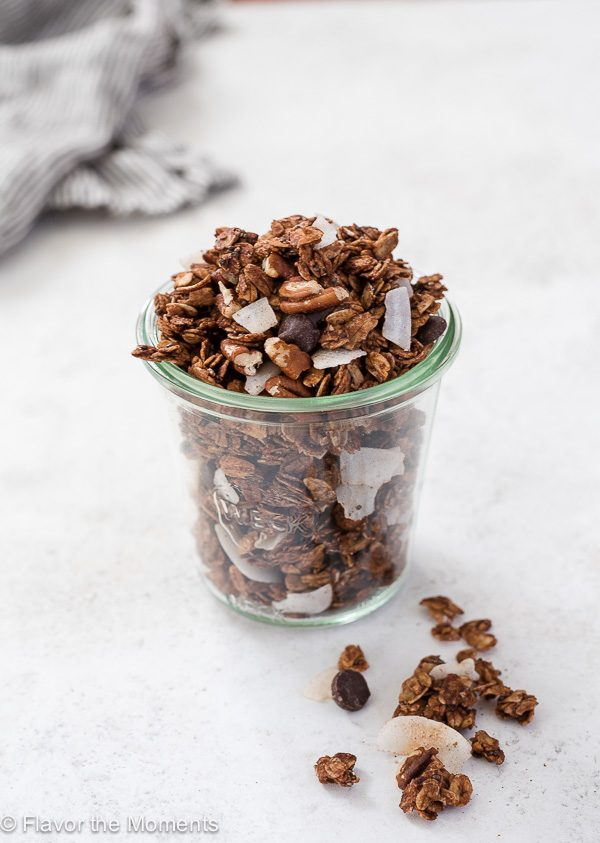 German chocolate granola in jar with linen behind